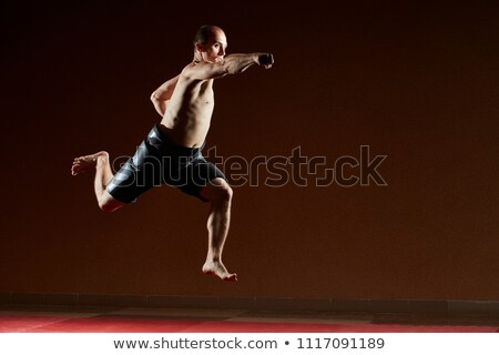 Athlete trains a jab with a hand in jump Stock photo © Andreyfire