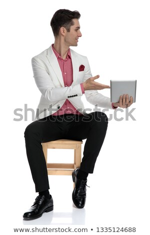 seated young businessman recommending tablet to his side  Stock photo © feedough