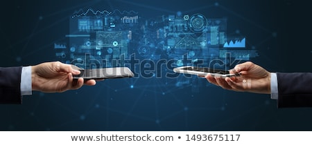 close up of two hands holding smartphones stock photo © ra2studio