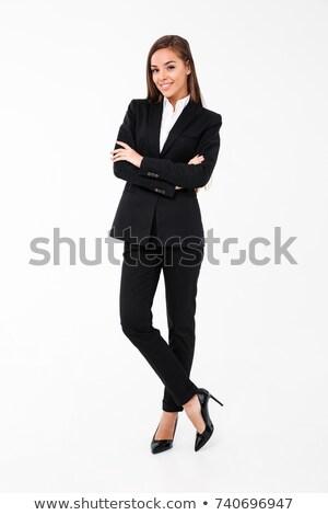 Zdumiewający business woman stwarzające odizolowany biały ściany Zdjęcia stock © deandrobot