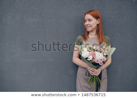 Smiling talented young female florist with red hair Stock photo © pressmaster