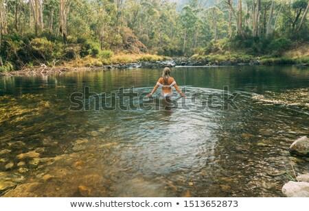 Woman wading in thermal springs in Australia Stock photo © lovleah