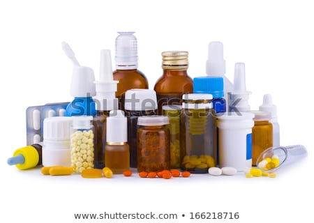 Medicine bottle with yellow label isolated on blue background.  Your text can be on the yellow label stock photo © johnkwan
