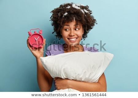 happy sleepy woman in blue pajama holding pillow Stock photo © dolgachov