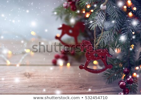 Christmas composition with wooden toy rocking horse Stock photo © Melnyk