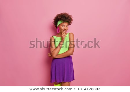Indoor shot of glad optimistic dark skinned lady touches forehead, has curly Afro hair, giggles posi Stock photo © vkstudio