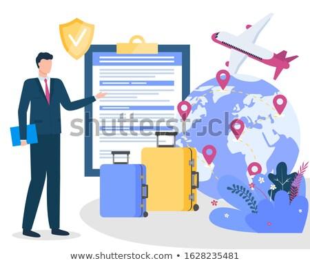 Podróży ubezpieczenia notebooka świecie płaszczyzny biznesmen Zdjęcia stock © robuart