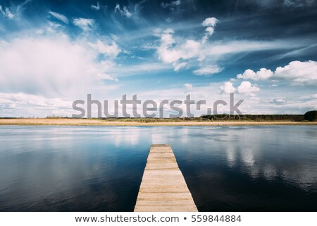 Old pier and dramatic sky Stock photo © johnnychaos