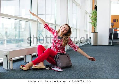 young woman with luggage at the international airport she is fl stock photo © hasloo