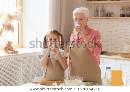 mature woman drinking milk Stock photo © photography33