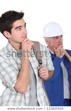A manual worker and his trainee thinking. Stock photo © photography33