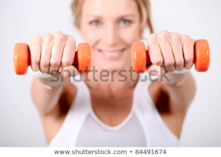 woman using hand weights during fitness session stock photo © photography33