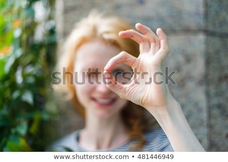 mulher · olhando · buraco · dedos · quadro · mão - foto stock © dolgachov