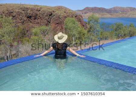Woman relaxed outback lake Australia Stock photo © roboriginal