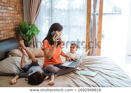 vonzó · fiatal · lány · laptop · fehér · ágy · fektet - stock fotó © carlodapino