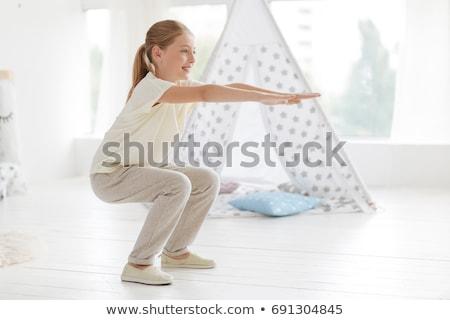 Szőke hölgy görbület térd mosolyog izolált Stock fotó © acidgrey
