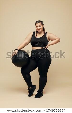 plus size woman with pilates ball   full body stock photo © lisafx