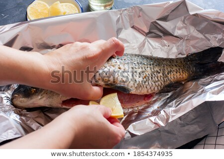raw Carp  in Foil Stock photo © papa1266