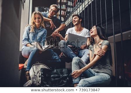 Happy student in the library Stock photo © wavebreak_media