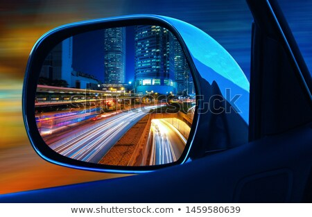 rearview car driving mirror view city downtown Stock photo © lunamarina