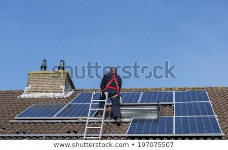 Adam tırmanma merdiven çatı ev Stok fotoğraf © compuinfoto