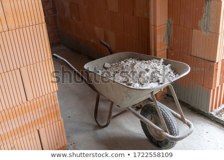 Wheelbarrow with rubble Stock photo © Hofmeester