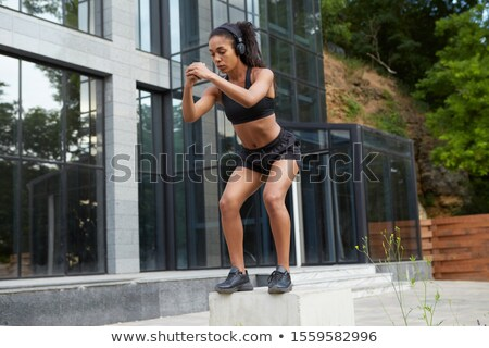 Athlete posing outdoors in city. Standing with hands folded stock photo © HASLOO