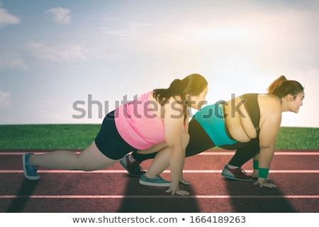 happy fatty fit woman posing outdoor stock photo © witthaya
