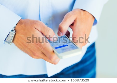 Stock fotó: Fiatalember · küldés · szöveges · üzenetek · jól · kinéző · dolgozik · iroda