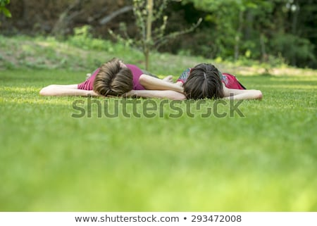Heureux femme herbeux sol jeune femme Photo stock © juniart