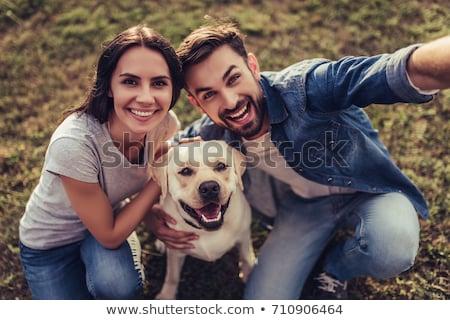 Sonriendo Pareja golden retriever blanco mujer perro Foto stock © wavebreak_media