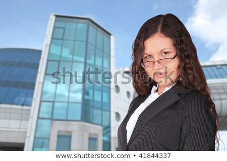 beautiful brown-haired woman near blue building, collage stock photo © Paha_L