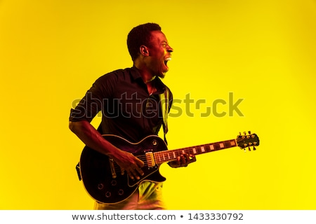 Homme blues guitare musique amusement noir Photo stock © alexanderandariadna