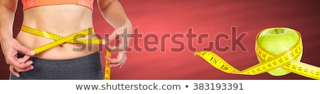 Mulher abdômen vermelho dieta Foto stock © Kurhan