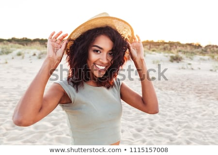 close up portrait of a young woman in beach hat stock photo © deandrobot