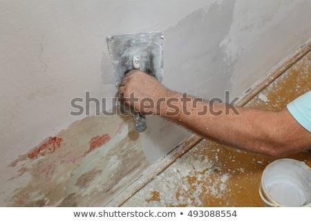 Travailleur endommagé mur plâtre main Photo stock © simazoran