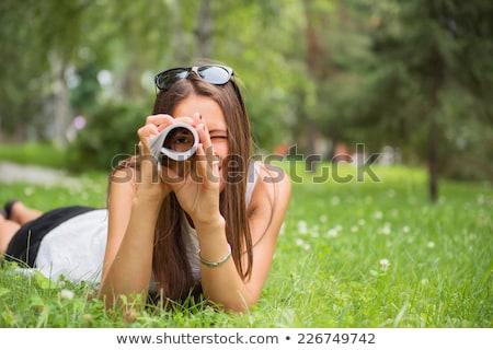 Sorrindo revista grama ao ar livre sorridente atraente Foto stock © deandrobot