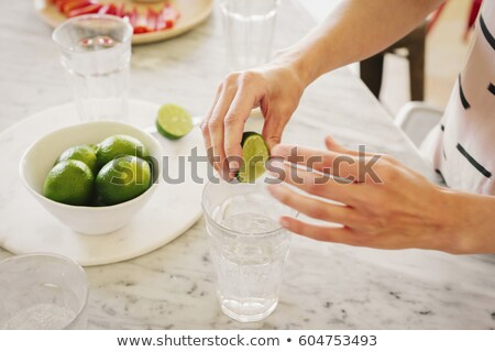 Produce - fruit woman with lime stock photo © dgilder