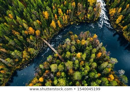 bridge over turquoise river stock photo © tasipas