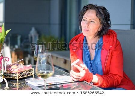 Mulher vinho branco vidro restaurante Foto stock © wavebreak_media