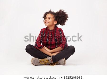 Сток-фото: Teenage Girl Sitting Against White Background