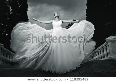 Young bride in white wedding dress outdoors Stock photo © dashapetrenko