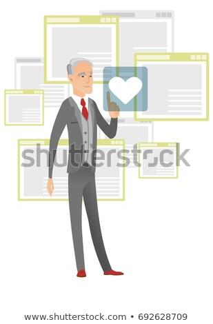 Senior businessman pressing web button with heart. Stock photo © RAStudio