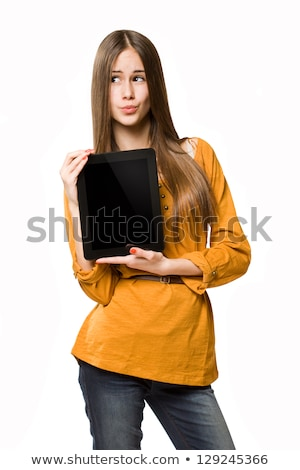 portrait of a young pensive woman holding tablet computer stock photo © deandrobot