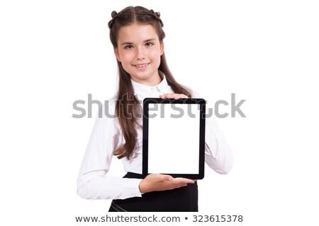 Gyönyörű iskolás lány üzlet öltöny tart tabletta Stock fotó © Traimak