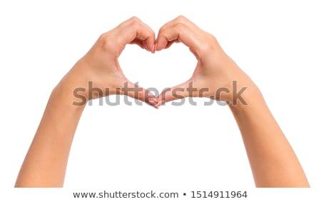 Forma de coração mãos em torno de vermelho amor mulher Foto stock © psychoshadow