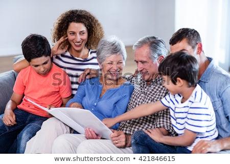 Apa fia néz fényképalbum nappali otthon szeretet Stock fotó © wavebreak_media