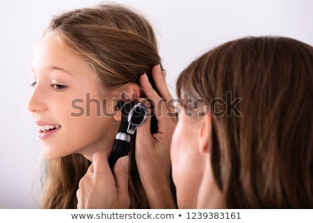 A Kids Checking Ear With Doctor Stock photo © bluering
