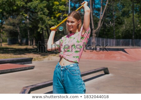 Smiling Blond Boy Ride on Skateboard at Skatepark Stock photo © robuart