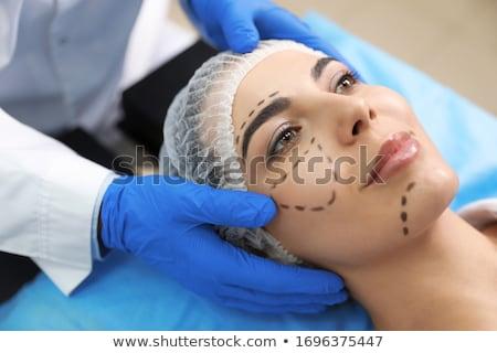 The plastic surgeon preparing for operation on man face Stock photo © Elnur